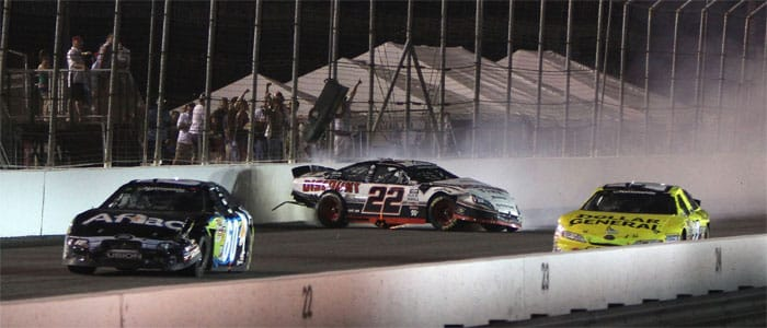 Coming to the checkered flag, Carl Edwards and Brad Keselowski tangle as the battle for the victory during the Missouri-Illinois Dodge Dealers 250. - Credit: Dilip Vishwanat/Getty Images