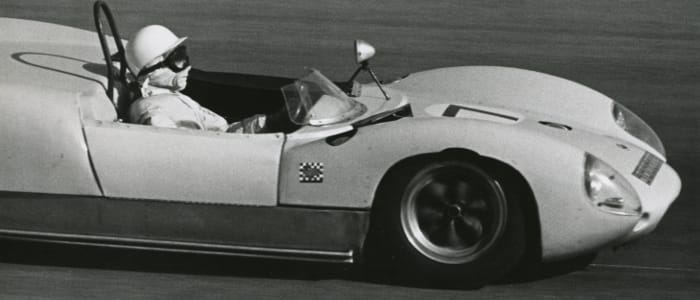 Stirling Moss driving a Lotus 19