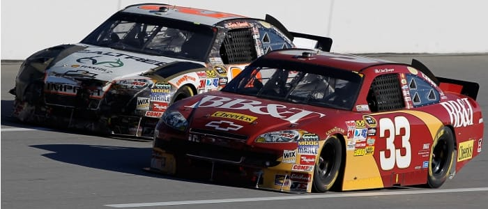 Bowyer hold off Harvick's battered car - Photo Credit: Todd Warshaw/Getty Images