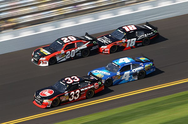 Joey Logano, Kyle Busch, Clint Bowyer and Tony Stewart fight for the lead during the Drive4COPD