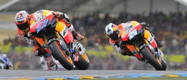 Casey Stoner leads - Photo Credit: motogp.com