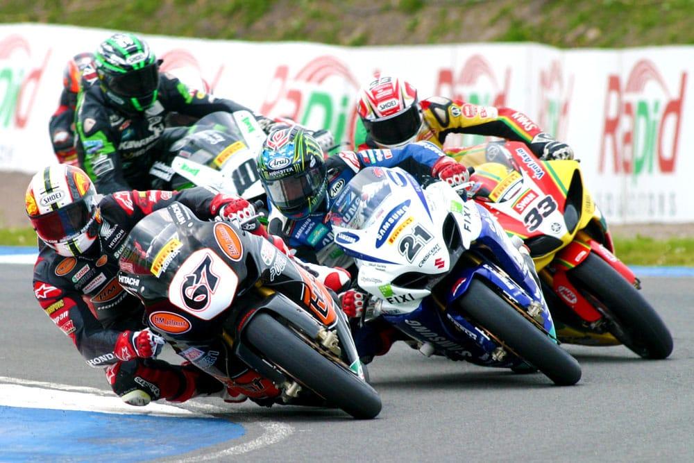 Shane Byrne (HM Plant Honda) leads John Hopkins (Samsung Crescent Racing Suzuki) and Tommy Hill (Swan Yamaha)