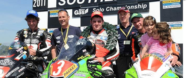 Michael Dunlop (centre) celebrates his Solo Championship win - Photo Credit: Stephen Davison - Pacemaker