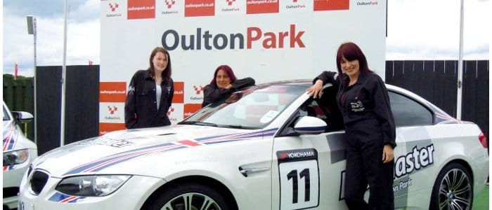 The students proudly show off the BMW M3 they prepared during the day