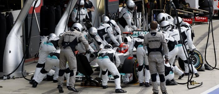 The Mercedes pit crew service Michael Schumacher's car during the British Grand Prix last weekend - Photo Credit: Mercedes GP
