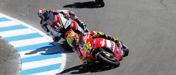 Ben Spies chases Valentino Rossi on the first lap - Photo Credit: MotoGP.com