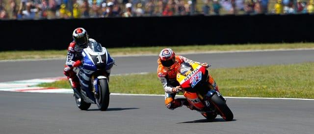 Jorge Lorenzo chases Casey Stoner - Photo Credit: MotoGP.com