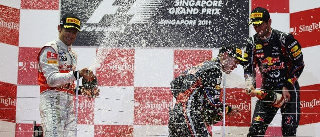 The podium celebrations in Singapore. From left to right: Jenson Button; Sebastian Vettel; Mark Webber - Photo Credit: Mark Thompson/Getty Images