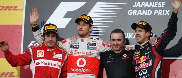 The Japanese Grand Prix podium: (Left to Right) Fernando Alonso (2nd); Jenson Button (1st); Paddy Lowe; Sebastian Vettel (3rd) - Photo Credit: Mark Thompson/Getty Images