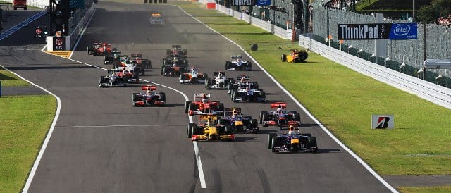 Sebastian Vettel leads the field in to the first corner at last year's British Grand Prix but the yellow Renault of Vitaly Petrov (right) only manages a few metres - Photo Credit: Mark Thompson/Getty Images