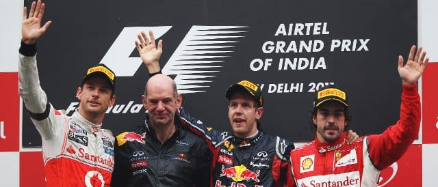 The Indian Grand Prix podium. (Left to right:) Jenson Button (2nd), Adrian Newey (Red Bull), Sebastian Vettel (winner), Fernando Alonso (3rd) - Photo Credit: Mark Thompson/Getty Images