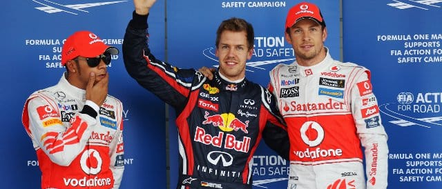 Vettel celebrates pole position in Japan with Jenson Button (2nd) whilst Hamilton (3rd) ponders what might have been if he had done another flying lap - Photo Credit: Mark Thompson/Getty Images