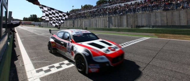 Andrea Bertolini takes the checkered flag at the end of the first race - Photo Credit: Superstars Series