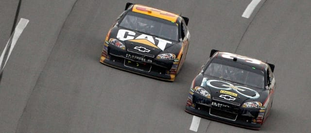 Clint Bowyer leads Jeff Burton towards the finish line (Photo Credit: Chris Graythen/Getty Images for NASCAR