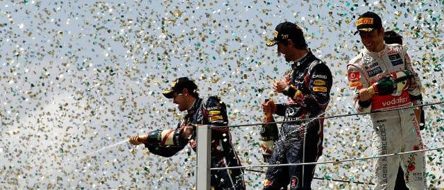 Podium celebrations in Brazil: (left to right) Sebastian Vettel (2nd), Mark Webber (Winner), Jenson Button (3rd) - Photo Credit: Paul Gilham/Getty Images