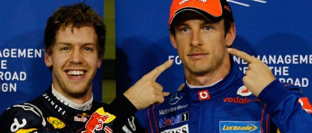 Vettel (left) highlights Jenson Button's support for 'Movember' shortly after collecting pole position for the Abu Dhabi Grand Prix  - Photo Credit: Paul Gilham/Getty Images