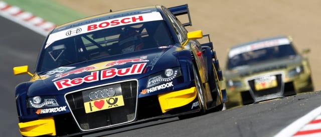 DTM cars race towards Druids