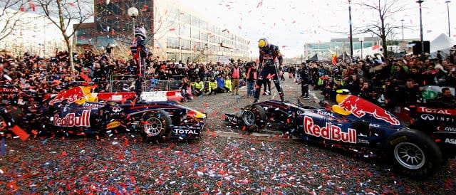 Sebastian Vettel (left) and Mark Webber are greeted by enthusiastic fans in the centre of Milton Keynes - Photo Credit: Mark Thompson/Getty Images for Red Bull