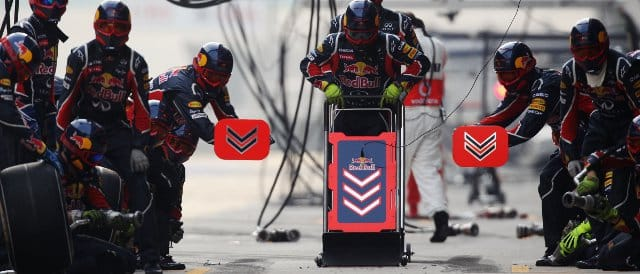 Button found this sight a bit too welcoming as he came in for his first stop in China. Unfortunately, these mechanics were waiting for Mark Webber - Photo Credit: Mark Thompson/Getty Images
