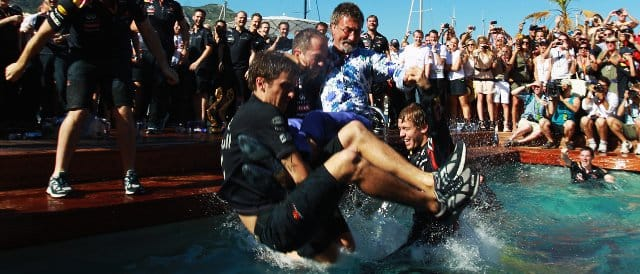 Sebastian Vettel celebrates his victory in Monaco by persuading Eddie Jordan to go for a swim - Photo Credit: Paul Gilham/Getty Images