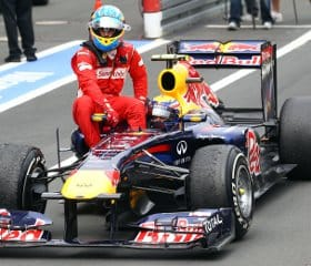 Fernando Alonso had to park his Ferrari after crossing the finish line in Germany, but luckily Mark Webber was on hand to give him a lift back to the podium - Photo Credit: Julian Finney/Getty Images