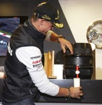 If this F1 thing doesn't work, Schumacher could always find work as a barman... - Photo Credit: Mercedes GP