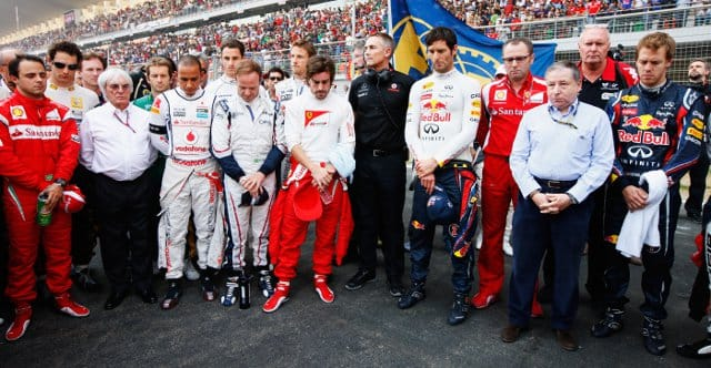 Drivers and team bosses pay their respects to Dan Wheldon and Marco Simoncelli with a minutes silence on the grid at the Indian Grand Prix - Photo Credit: Mark Thompson/Getty Images