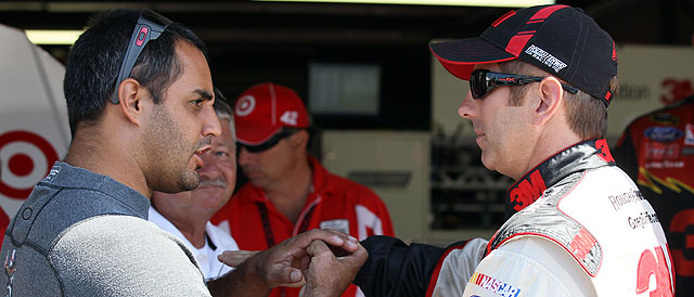 Juan Pablo Montoya and Greg Biffle talking during 2011 - Credit:  Elsa/Getty Images for NASCAR