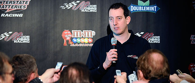 Kyle Busch talking to the media - Credit: Jared C. Tilton/Getty Images for NASCAR