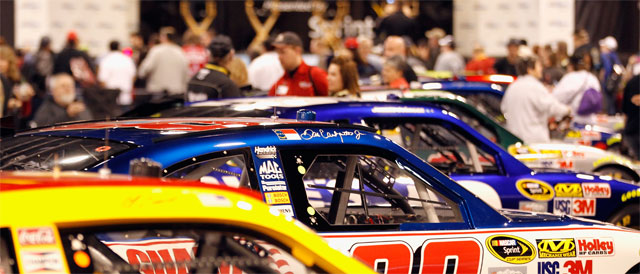 Race cars are lined up for fans to see - Credit: Streeter Lecka/Getty Images for NASCAR