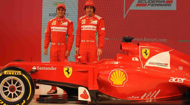 Felipe Massa (left) and Fernando Alonso helped to unveil the new car today - Photo Credit: Ferrari