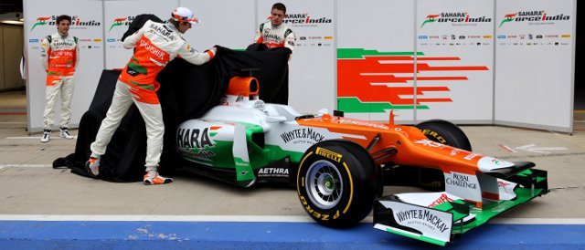 Bianchi watched on as Nico Hulkenberg and Paul di Resta (right) pull the covers off the new VJM05 - Photo Credit: Sahara Force India F1 Team