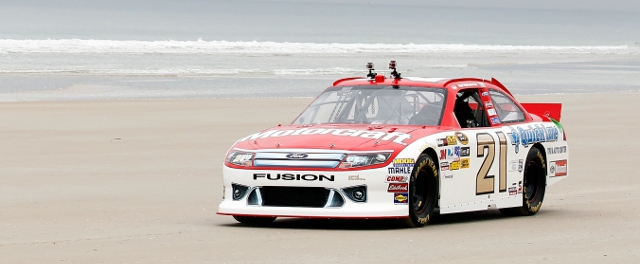 Bayne takes his no.21 down the historic beach road at Daytona (Photo Credit: Todd Warshaw/Getty Images for NASCAR)