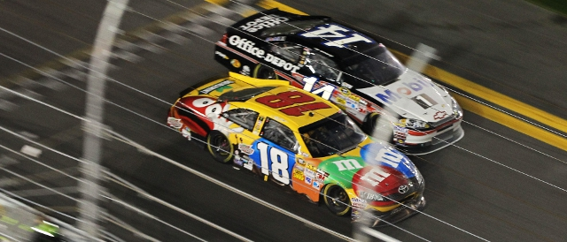 Kyle Busch (18) beat Tony Stewart to the line. Just (Photo Credit: Jamie Squire/Getty Images)