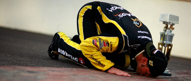 Paul Menard kisses the bricks after his victory in Indianapolis (Photo Credit: Tom Pennington/Getty Images for NASCAR)