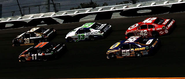 NASCAR Sprint Cup cars on the high banks of Daytona International Speedway (Photo Credit: Tom Pennington/Getty Images for NASCAR)