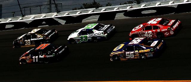 NASCAR Sprint Cup cars on the high banks of Daytona International Speedway (Photo Credit: Tom Pennington/Getty Images for NASCAR)