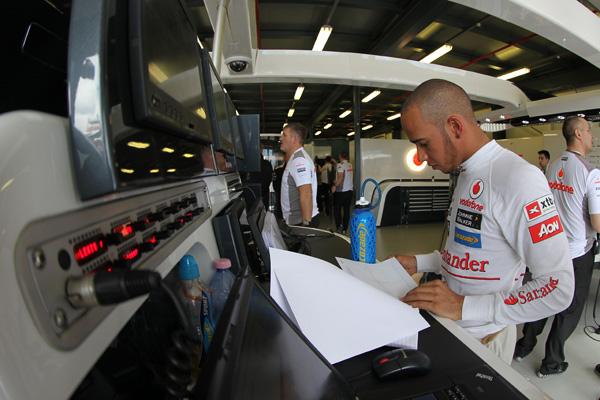 Lewis Hamilton looks over the data - Photo: Vodafone McLaren Mercedes