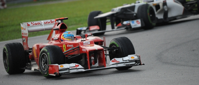 Fernando Alonso leads Sergio Perez into the race's closing stages (Photo Credit: Ferrari.com)