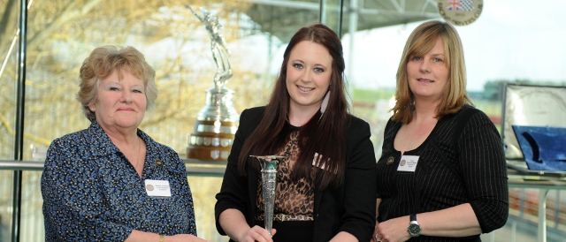 Zoe Wenham holding the Chairman's Cup with BWRDC Vice-chairman Natalie Goodwin and Chairman Helen Bashford-Malkie (Photo Credit: Jeff Bloxham)