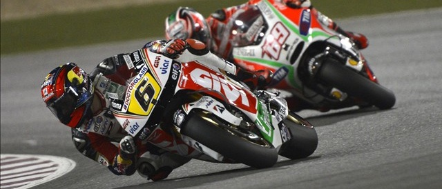 Stefan Bradl leads Nicky Hayden - Photo Credit: LCR Honda