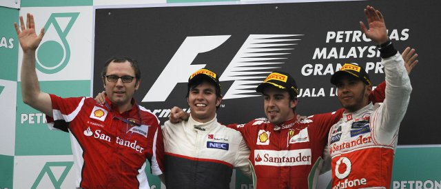 The Malaysia Podium: (Left to right) Stefano Domenicali, Sergio Perez (2nd), Fernando Alonso (winner) and Lewis Hamilton (3rd) - Photo Credit: Ferrari