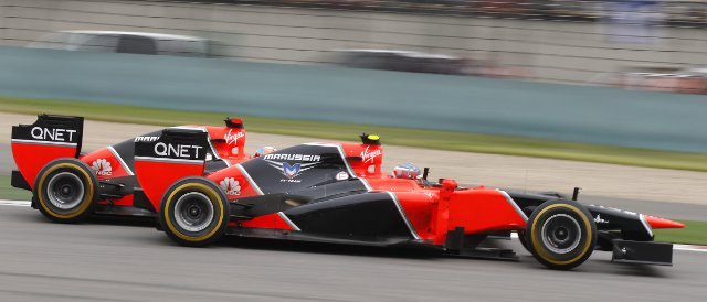 Charles Pic (front) and Marussia team-mate Timo Glock do battle on track in the Chinese Grand Prix - Photo Credit: Marussia F1 Team