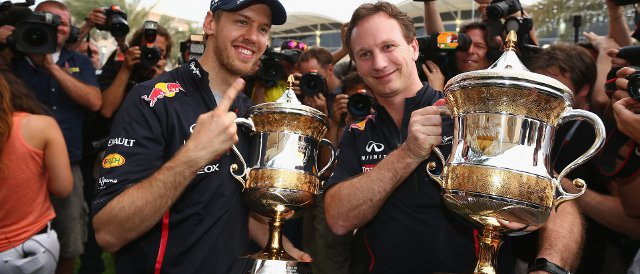 Sebastian Vettel (left) and Red Bull team principal Christian Horner show off their trophies in Bahrain - Photo Credit: Clive Mason/Getty Images