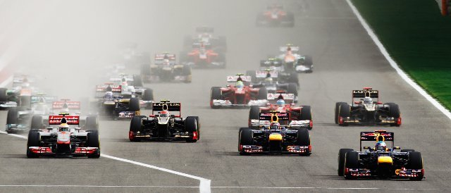 Sebastian Vettel leads the field off the line at the start of the Bahrain Grand Prix - Photo Credit: Paul Gilham/Getty Images