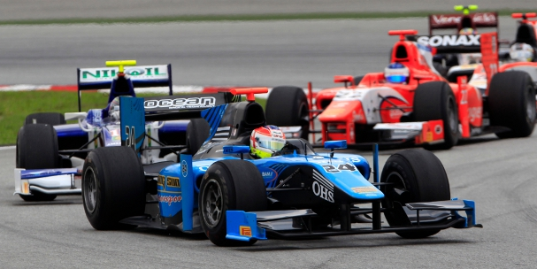 Lancaster leads a group of drivers through turns one and two at Kuala Lumpur (Photo Credit: Glenn Dunbar/GP2 Series Media Service)