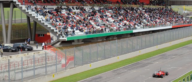 Fernando Alonso passes a well-populated grandstand on a wet day in Mugello - Photo Credit: Ferrari