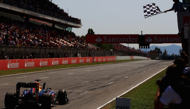 Vettel takes the chequered flag in Spain last year. This race and Turkey (also won by Vettel) were the only two events in which the winner used a four-stop strategy - Photo Credit: Vladimir Rys/Getty Images