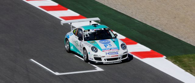 Christian Engelhart came out on top in a closely fought Porsche Mobil 1 Supercup qualifying session at Barcelona's Circuit de Catalunya, edging out Kuba Giermaziak for top spot by just three thousandths of a second.