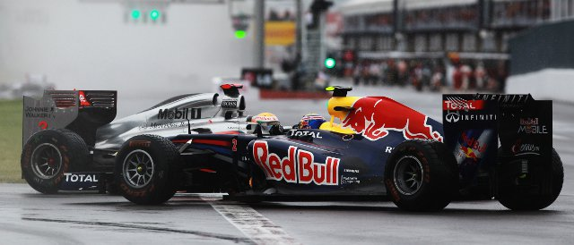 Scenes like this one between Lewis Hamilton and Mark Webber last year are quite common in Montreal, even when it isn't raining - Photo Credit: Paul Gilham/Getty Images